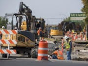 Construction workers tackle a big road project at the intersection of Northeast Highway 99 and Northeast 99th Street in Hazel Dell on Wednesday afternoon.
