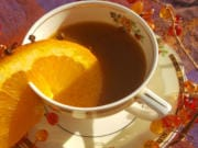 Orange, cinnamon and cloves are a classic fall combination -- and this warm tea's dark orange color makes it just right for Halloween and harvest season.