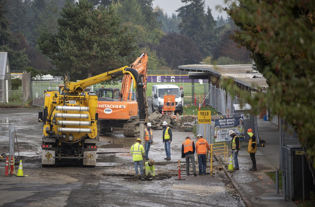 Contractors work a water main break at Columbia River High School in Vancouver on Oct. 16, 2020.