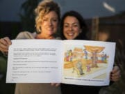 "Illustrator Julie Dee, left, and author Solina Adelson-Journey are pictured with their book, ""When the City Went Quiet,"" in Vancouver. The friends collaborated on a children's book about the coronavirus pandemic."