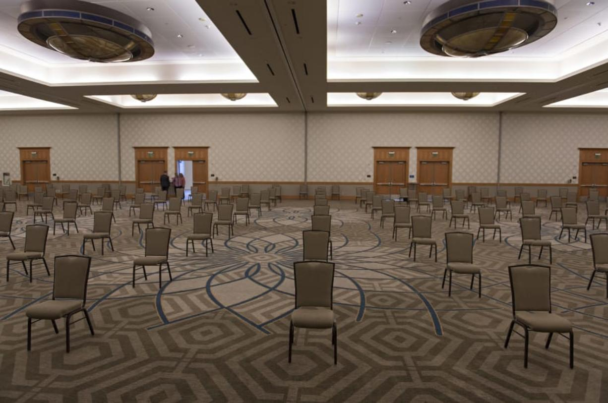 Staff at the Hilton Vancouver Washington prepare for an upcoming socially distanced meeting. The hotel is starting to see some meetings return to its convention center, Mike McLeod said, the hotel's general manager. It has allowed the venue staff to hire some banquet workers back who were furloughed.