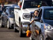 Abigail Pine, 7, screams in excitement as she sees costumed characters and goodie bags ahead of her during the fourth annual Booville, a drive-thru Halloween event put on by the Parks Foundation of Clark County at Vancouver Mall on Saturday. Abigail dressed as a kitten.