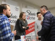 Dmitriy Sashchenko, left, Liliya Zhukova and Andrey Georgiyev last spring founded Slavic Vote, a group focused on registering Slavics to vote and educating them about the elections process.
