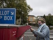 Sydney Bardurian of Vancouver makes sure her vote counts by swinging by the downtown ballot drop-off box Thursday afternoon.