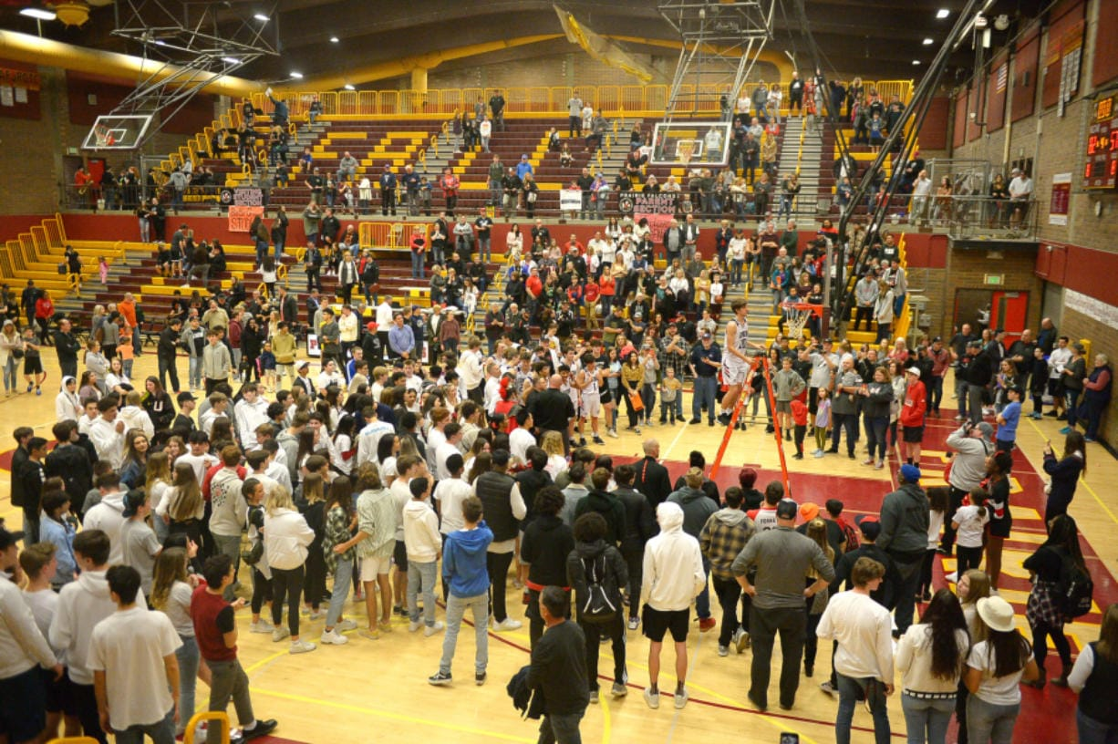 Scenes like this, after Union won the 4A bi-district boys basketball championship, won't happen until COVID-19 cases fall under 25 per 100,000 residents in Clark County. Only then will spectators beyond one parent/guardian be allowed at high school events, according to WIAA and state guidelines released Tuesday.