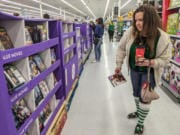 Heather Peeples shops for deals on DVDs at Walmart during Black Friday last year.