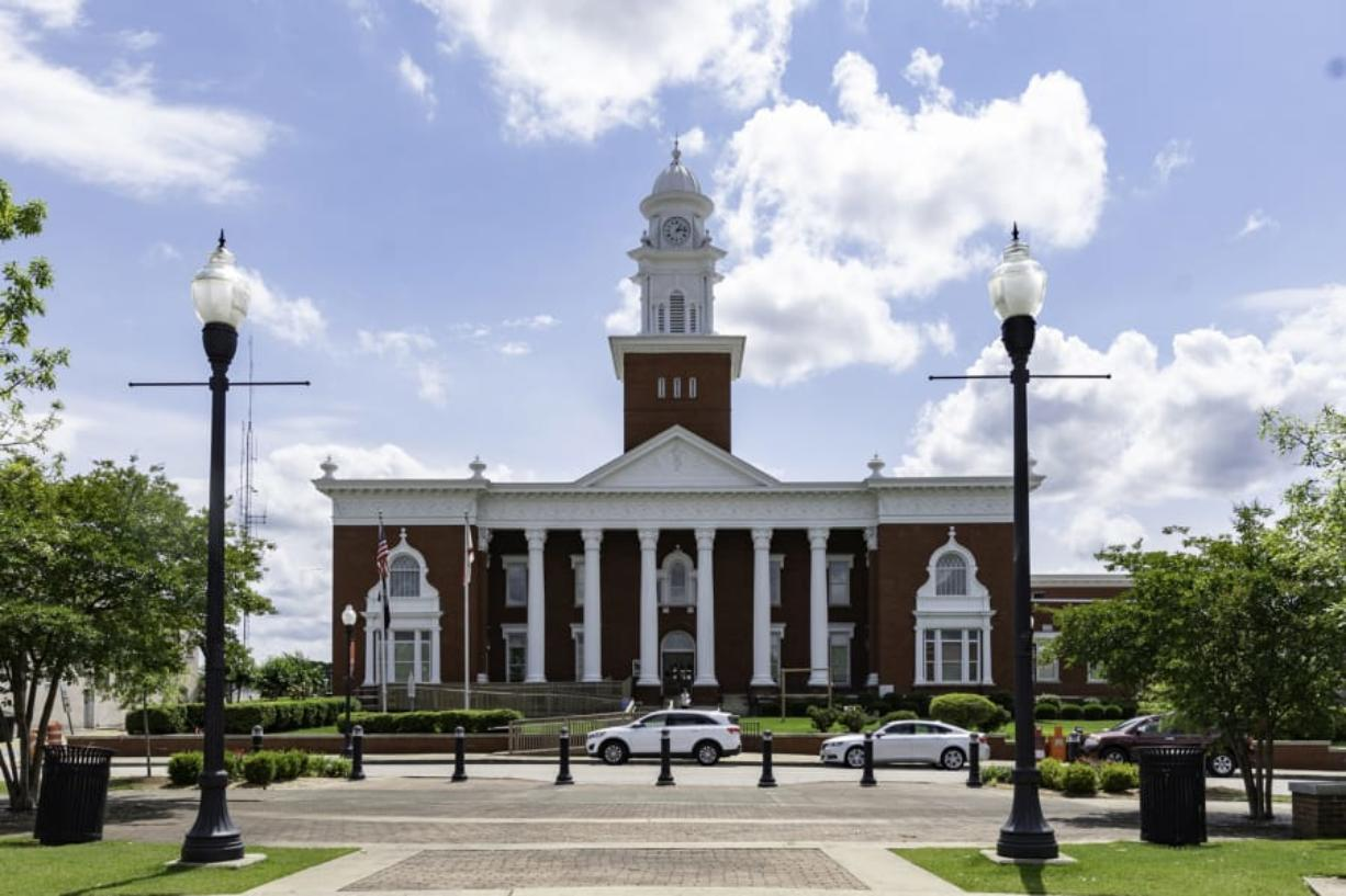The exterior of Lee County Courthouse in Opelika, Alabama, where Barry Wilson and other relatives have been fighting a complicated legal battle for their share of family land. Tax and partition sales are among the legal actions that have precipitated the loss of Black-owned land in Mississippi and across the country.