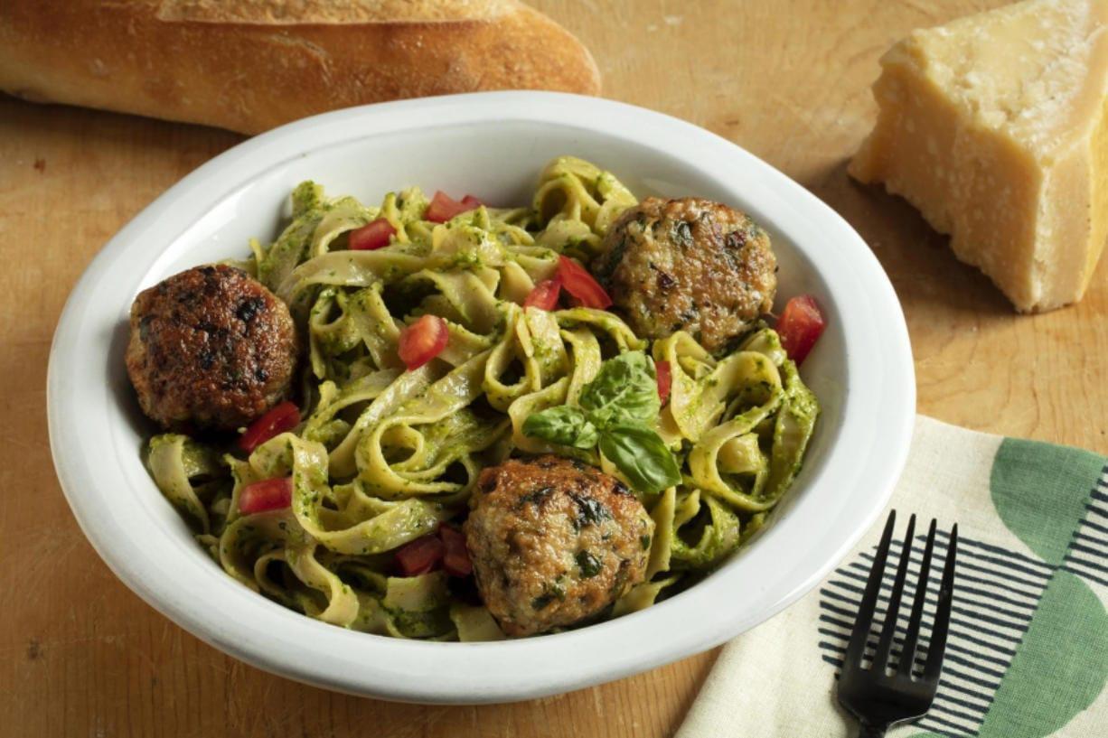 Fettucine with cilantro-almond pesto and chicken meatballs. (E.