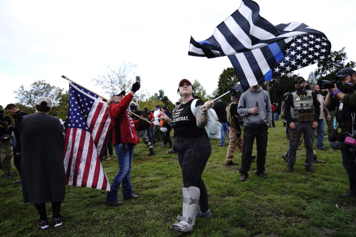 Members of the Proud Boys and other right-wing demonstrators rally on Saturday, Sept. 26, 2020, in Portland, Ore.