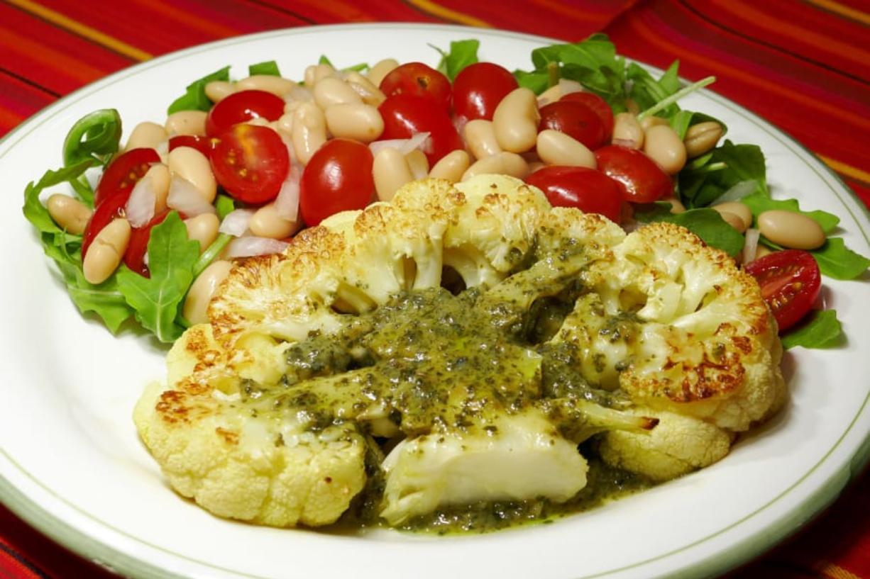 Cauliflower steak with bean and tomato salad.