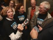 WEB ONLY Pro-charter supporters, from left, Betty Sue Morris, Patty Reyes and Joe Toscano react to early election results at Grant House on Election night in 2014. Morris was co-chair for the campaign.