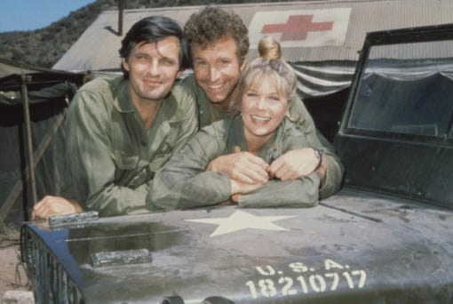 """Alan Alda, from left, with Wayne Rogers and Loretta Swit on """"M*A*S*H."""" (Tribune News Service)"""