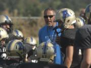 Adna football coach KC Johnson talks to his team during a preseason scrimmage in 2015. Johnson was a senior quarterback at Toledo High in 1983, when Toledo and Ridgefield played seven overtimes to set a state record.