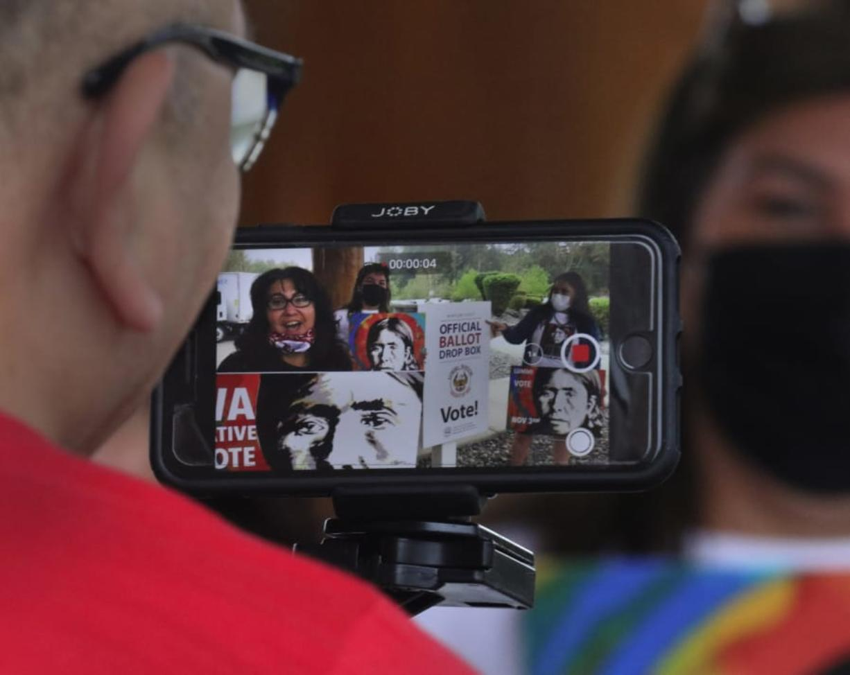 Lummi tribal members record a public service announcement about getting out the Native vote on October 7, 2020, north of Bellingham, Washington.