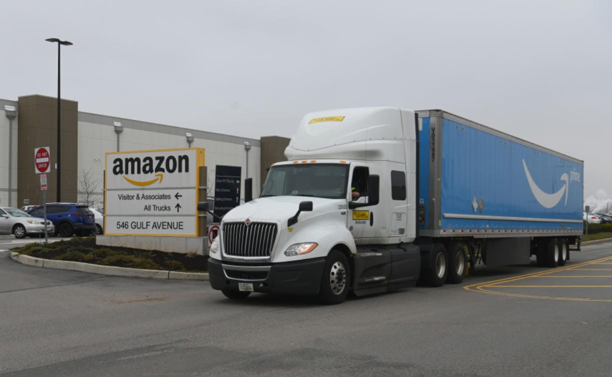 A truck is seen outside the Amazon warehouse in Staten Island as workers strike in demand that the facility be shut down and cleaned after one staffer tested positive for the coronavirus on March 30, 2020 in New York. Amazon's warehouses have more costly workplace injury claims than meatpacking or logging, Washington state says.