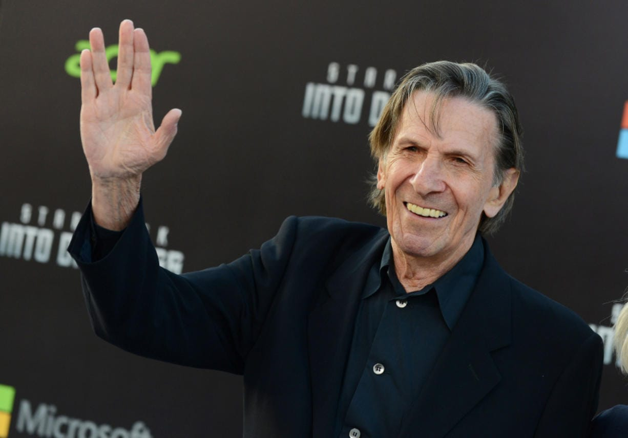 """The late Leonard  Nimoy flashes the Vulcan Salute as he arrives for a """"Star Trek"""" movie premiere on May 14, 2013, in Los Angeles."""