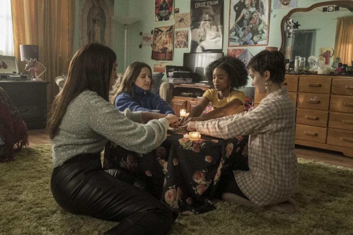 "Lourdes (Zoey Luna), from left, Frankie (Gideon Adlon), Tabby (Lovie Simone), and Lily (Cailee Spaeny) perform rituals and talk about being cautious with their gifts in Columbia Pictures' ""The Craft: Legacy."" (Rafy Photography/Columbia Pictures)"