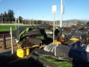 Rolls of artificial turf is stacked up around the new field installation projects at Union High School, Oct. 27, 2020.