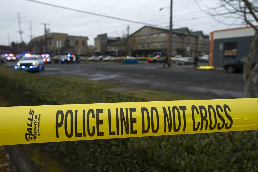 Crime scene tape surrounds the scene of a police shooting in downtown Vancouver on Feb. 28, 2019.