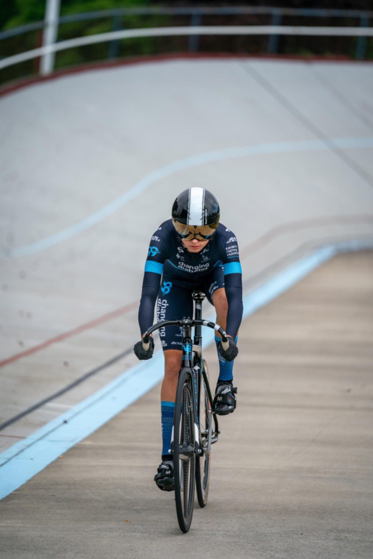 Vancouver native McKenna McKee rides her bike at the Alpenrose Velodrome in Portland. Track cycling is a grueling sport where riders compete in short races inside a steeply banked oval, called a velodrome.