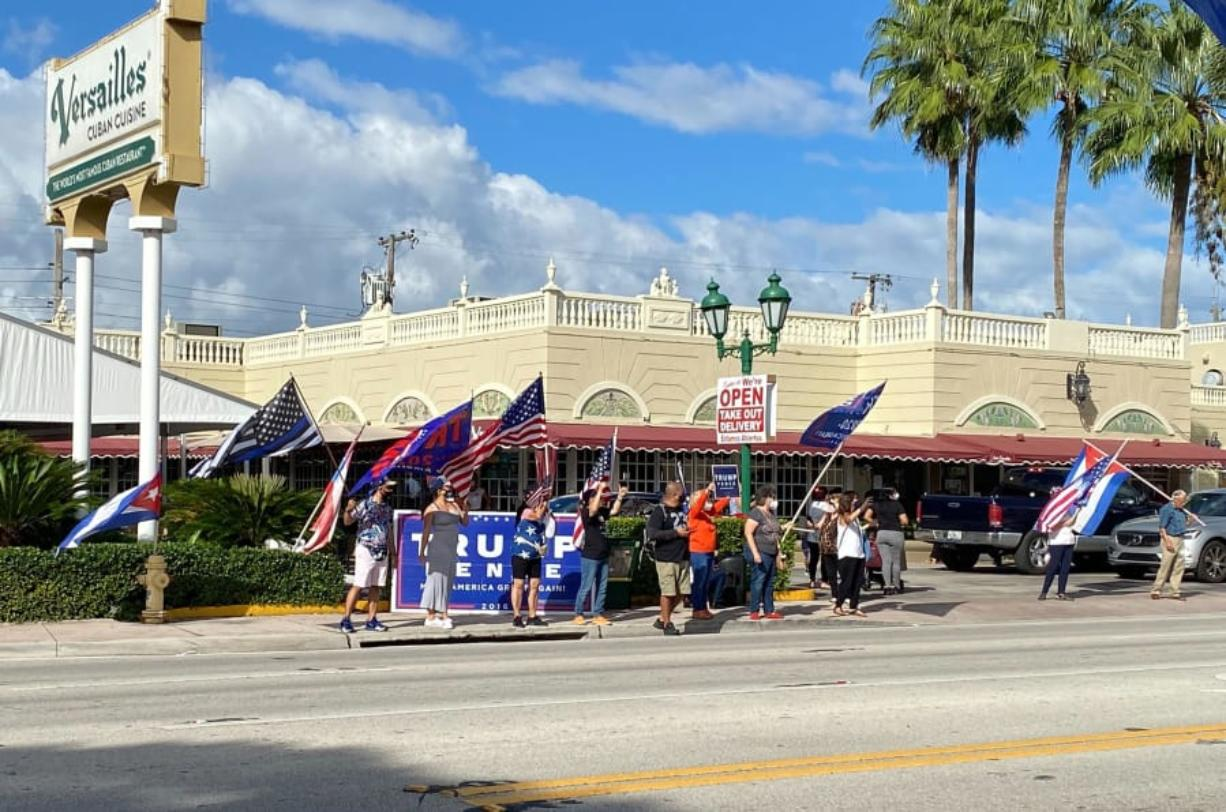 A group gathers at a Joe Biden caravan on Oct. 18, 2020 in Miami, Florida. A group of Donald Trump supporters gathered outside of Versailles and both sides shouted at one another.