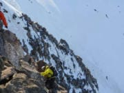 A pair of climbers trek up Mount Jefferson.