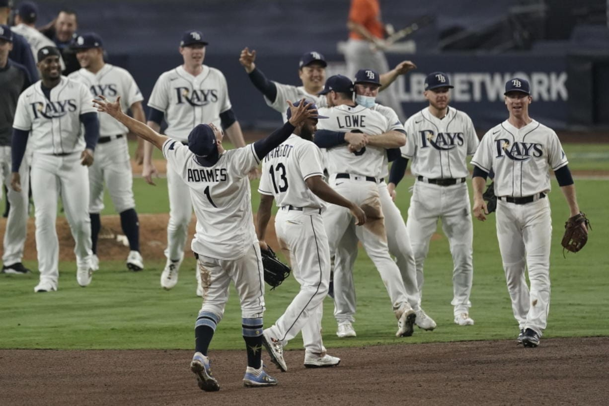 Tampa Bay Rays celebrate their victory against the Houston Astros in Game 7 of a baseball American League Championship Series, Saturday, Oct. 17, 2020, in San Diego. The Rays defeated the Astros 4-2 to win the series 4-3 games.(AP Photo/Jae C.