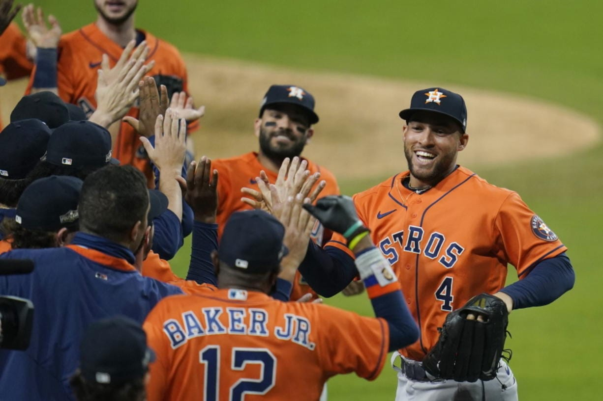 Houston Astros George Springer (4) and Jose Altuve celebrates with his teammates after winning Game 6 of a baseball American League Championship Series against the Houston Astros, Friday, Oct. 16, 2020, in San Diego. The Astros defeated the Rays 7-4 to tie the series 3-3.