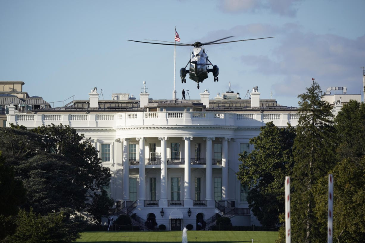 "The helicopter that will carry President Donald Trump to Walter Reed National Military Medical Center in Bethesda, Md., lands on the South Lawn of White House in Washington, Friday, Oct. 2, 2020. The White House says Trump will spend a ""few days"" at the military hospital after contracting COVID-19. (AP Photo/J."