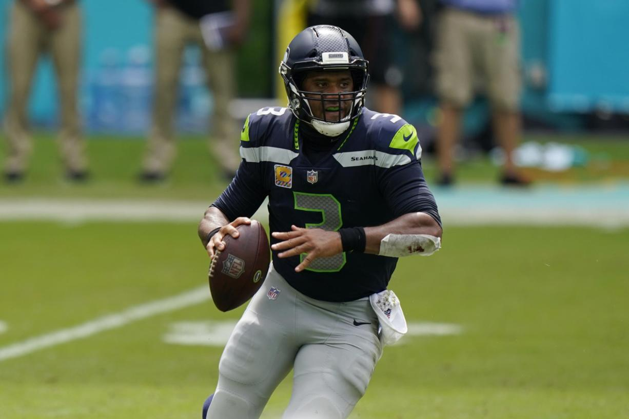 Seattle Seahawks quarterback Russell Wilson (3) looks to pass the ball during the first half of an NFL football game against the Miami Dolphins, Sunday, Oct. 4, 2020 in Miami Gardens, Fla.
