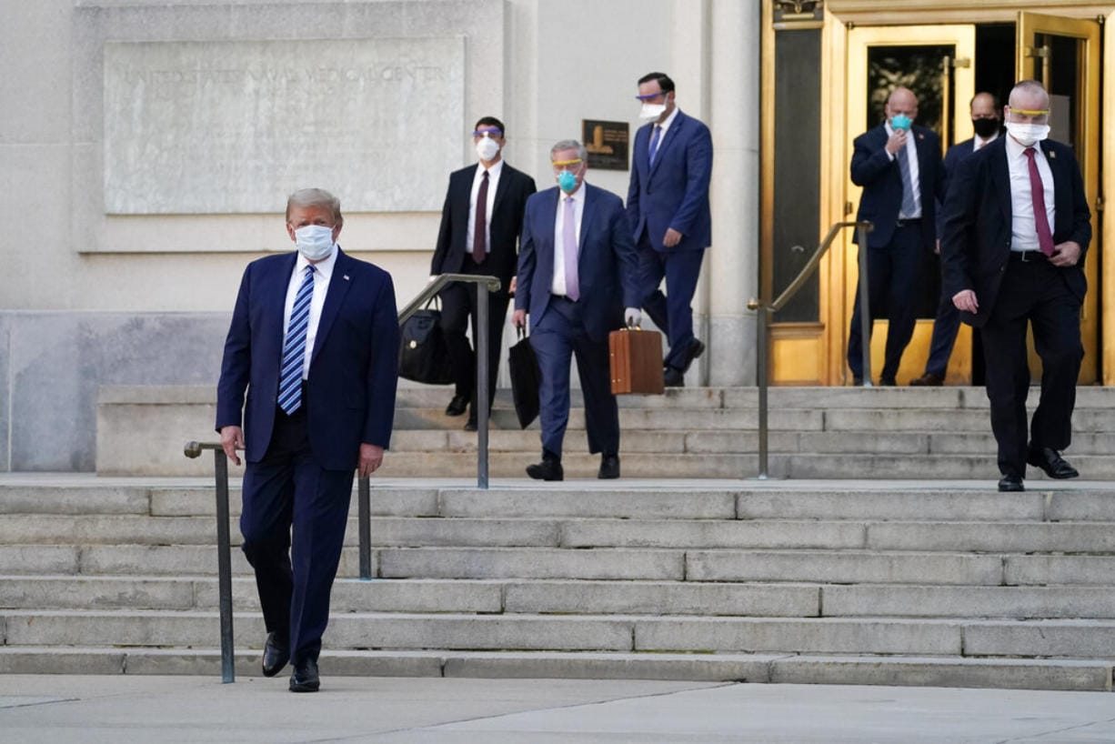 President Donald Trump walks out of Walter Reed National Military Medical Center to return to the White House after receiving treatments for covid-19, Monday, Oct. 5, 2020, in Bethesda, Md.