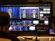 Washington gubernatorial candidates Gov. Jay Inslee, a Democrat, center-left, and Loren Culp, a Republican, center-right, are shown on a monitor in a video control room at the studios of TVW, Wednesday, Oct. 7, 2020, in Olympia, Wash., as they take part in a debate. Due to concerns over COVID-19, each candidate took part in the debate from individual rooms separate from moderators. (AP Photo/Ted S.