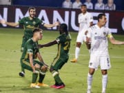 Portland Timbers forward Felipe Mora, front left, celebrates with midfielder Yimmi Chara, center, after scoring a goal against the LA Galaxy during the first half of an MLS soccer match in Carson, Calif., Wednesday, Oct. 7, 2020. (AP Photo/Ringo H.W.