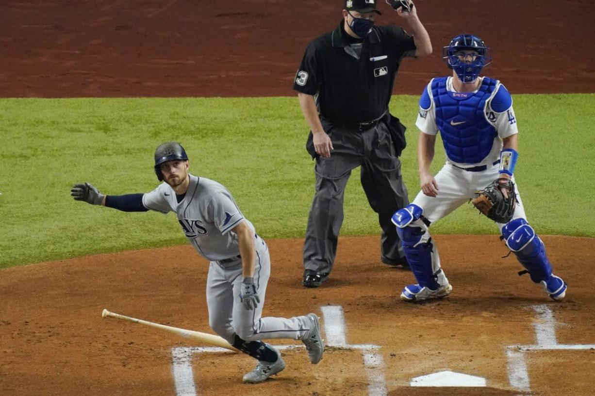 Tampa Bay Rays' Brandon Lowe watches his home run against the Los Angeles Dodgers during the first inning in Game 2 of the baseball World Series Wednesday, Oct. 21, 2020, in Arlington, Texas.