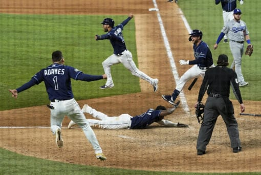 during the == inning in Game 4 of the baseball World Series Saturday, Oct. 24, 2020, in Arlington, Texas. Rays defeated the Dodgers 8-7 to tie the series 2-2 games.