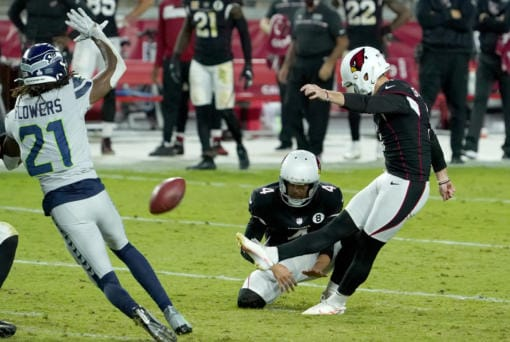 Arizona Cardinals kicker Zane Gonzalez kicks the game winning field goal as punter Andy Lee (4) holds during the second half of an NFL football game against the Seattle Seahawks, Sunday, Oct. 25, 2020, in Glendale, Ariz. The Cardinals won 37-34 in overtime.