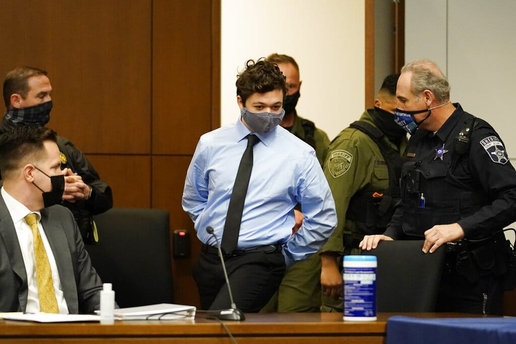 Kyle Rittenhouse appears for an extradition hearing in Lake County court Friday, Oct. 30, 2020, in Waukegan, Ill. The 17-year-old is accused of killing two demonstrators in Kenosha, Wis.,  on Aug. 25, 2020, two days after a police officer trying to arrest Jacob Blake shot him seven times in the back, paralyzing him from the waist down.  (AP Photo/Nam Y.