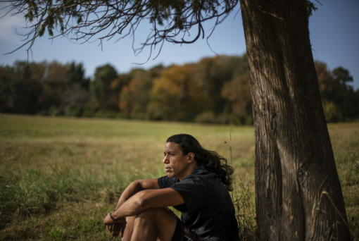 """Annawon Weeden, 46, a member of the Mashpee Wampanoag Tribe, sits for a portrait outside his home in Oakdale, Conn., Friday, Sept. 25, 2020. """"How do you pay somebody for that?"""" said Weeden when asked if governments should make financial reparations to Native people. """"The most valuable thing anyone can have or possess ever is time and you don't get that time back. I don't get my ancestors back. It's degrading to think that you could buy your way out of what you put us in. Actions speak for themselves,"""" Weeden said. """"You don't got to pay me a dime. Clean up your community, show some respect. Pay the land the respect. It's never about me. It's about this land. I'm only here for a short time. This land had to last a lot longer. Your children are going to have to inherit this. What do you want to leave them?"""