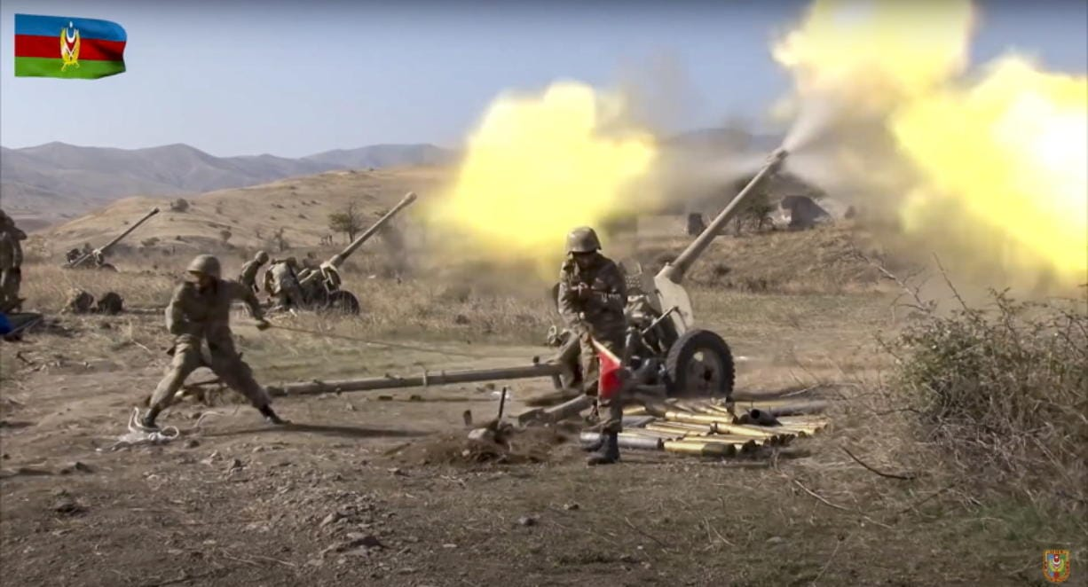 In this image taken from video released by Azerbaijan's Defense Ministry on Tuesday, Oct. 20, 2020, Azerbaijan army soldiers fire an artillery piece during fighting with forces of the self-proclaimed Republic of Nagorno-Karabakh. Azerbaijan Defense Ministry claims that Armenian forces tried to carry out an offensive that was met by an artillery strike from Azerbaijan, causing a large number of casualties among Armenian forces.