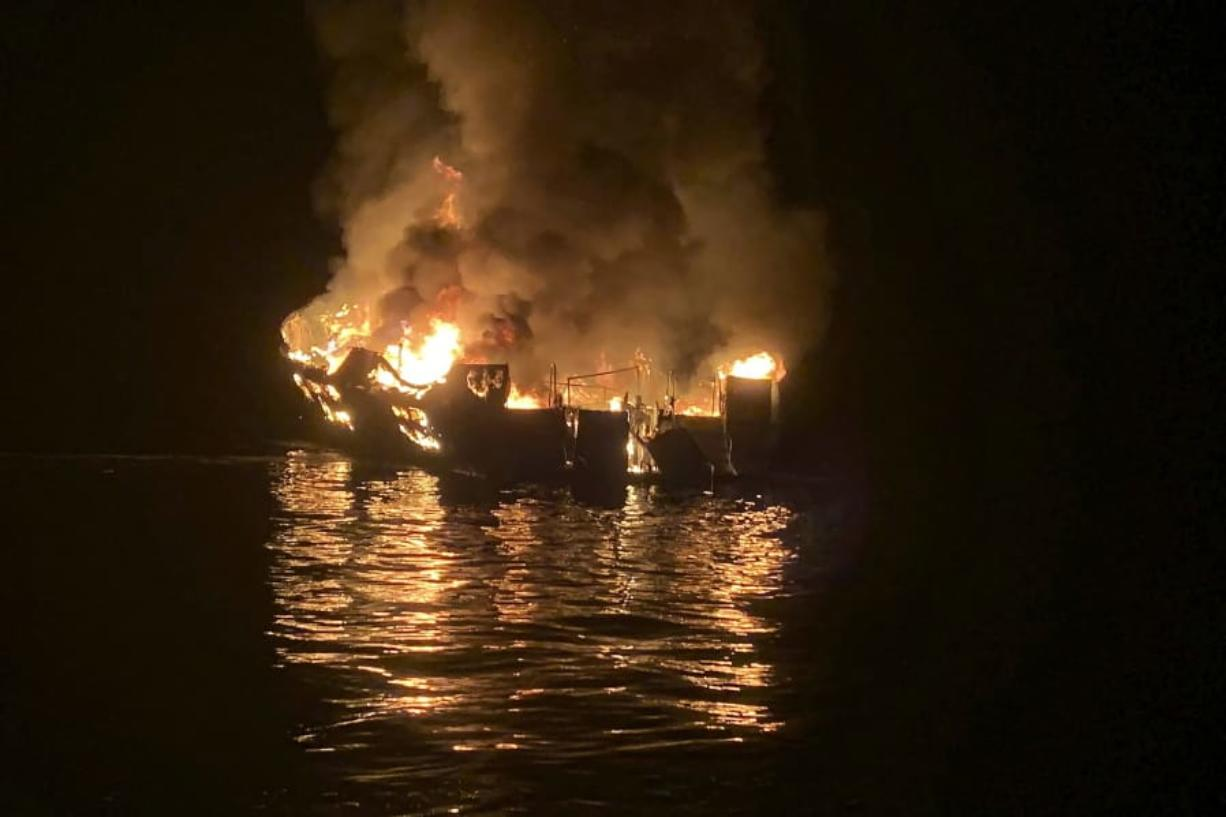 FILE - In this Sept. 2, 2019, file photo provided by the Santa Barbara County Fire Department, the dive boat Conception is engulfed in flames after a deadly fire broke out aboard the commercial scuba diving vessel off the Southern California Coast. Federal authorities are expected to vote Tuesday, Oct. 20, 2020 on what likely sparked a fire aboard a scuba dive boat last year that killed 34 people off the coast of Southern California. The pre-dawn blaze aboard the Conception is one of California's deadliest maritime disasters, prompting both criminal and safety investigations into the Sept. 2, 2019 tragedy that claimed the lives of 33 passengers and one crew member on a Labor Day weekend expedition near an island off Santa Barbara.