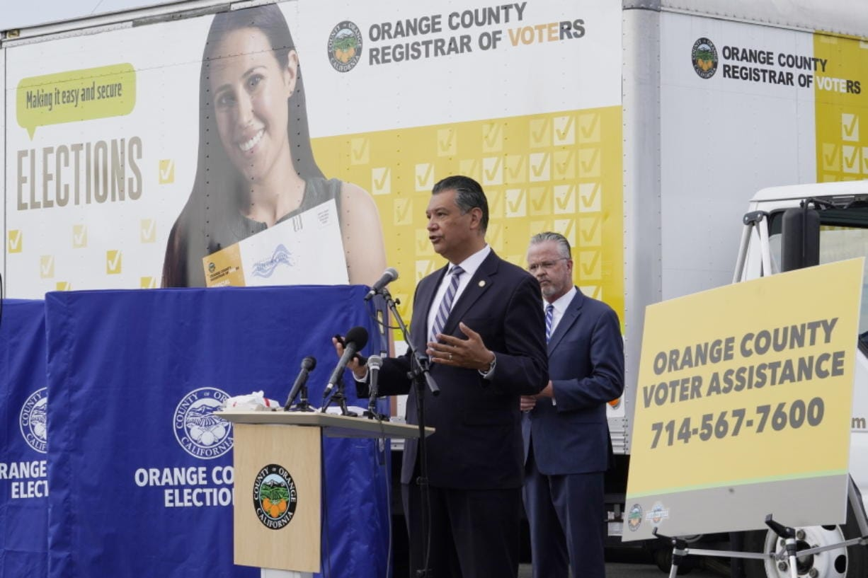 FILE - In this Oct. 5, 2020, file photo, California Secretary of State Alex Padilla, left, and Orange County Registrar of Voters Neal Kelley hold a news conference on Orange County's comprehensive plans to safeguard the election and provide transparency in Santa Ana, Calif. California election officials have received reports that unofficial ballot drop boxes were placed in several counties and said these set-ups are illegal. The Orange County Register reports Monday, Oct. 12, 2020, that Secretary of State spokesman Sam Mahood said boxes were reported in Fresno, Los Angeles and Orange counties at locations including political party offices, candidate headquarters and churches. He said the state was looking into the origin of the boxes.