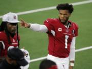 Arizona Cardinals' Kyler Murray (1) waves to fans in the stands in the first half of an NFL football game against the Dallas Cowboys in Arlington, Texas, Monday, Oct. 19, 2020.