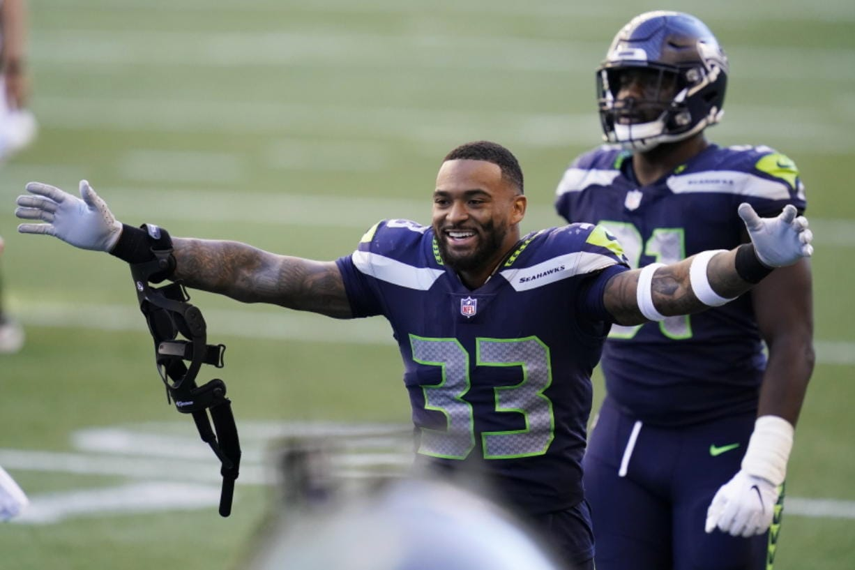 Seattle Seahawks strong safety Jamal Adams (33) celebrates after the Seahawks beat the Dallas Cowboys 38-31 in an NFL football game, Sunday, Sept. 27, 2020, in Seattle.