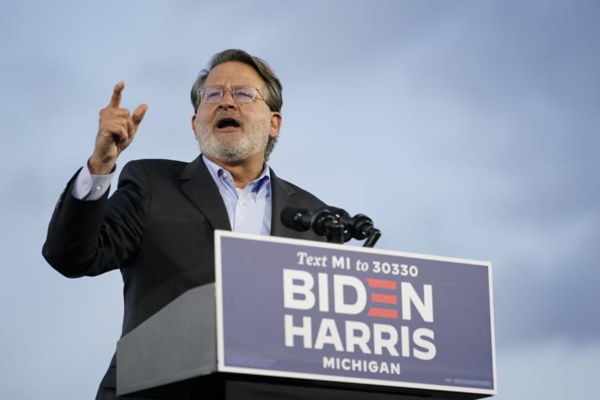 Sen. Gary Peters, D-Mich., speaks during an event for Democratic presidential candidate former Vice President Joe Biden at Michigan State Fairgrounds in Novi, Mich., Friday, Oct. 16, 2020.