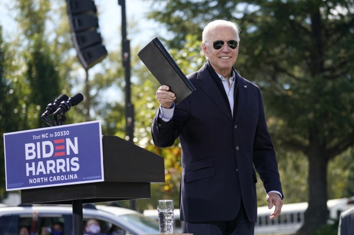 Democratic presidential candidate former Vice President Joe Biden turns from the podium after speaking during a campaign event at Riverside High School in Durham, N.C., Sunday, Oct. 18, 2020.