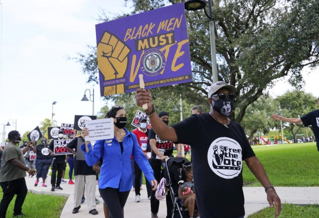 Supporters of restoring Florida felons' voting rights march to an early voting precinct, Saturday, Oct. 24, 2020, in Fort Lauderdale, Fla. The Florida Rights Restoration Coalition led marches to the polls in dozens of Florida counties.