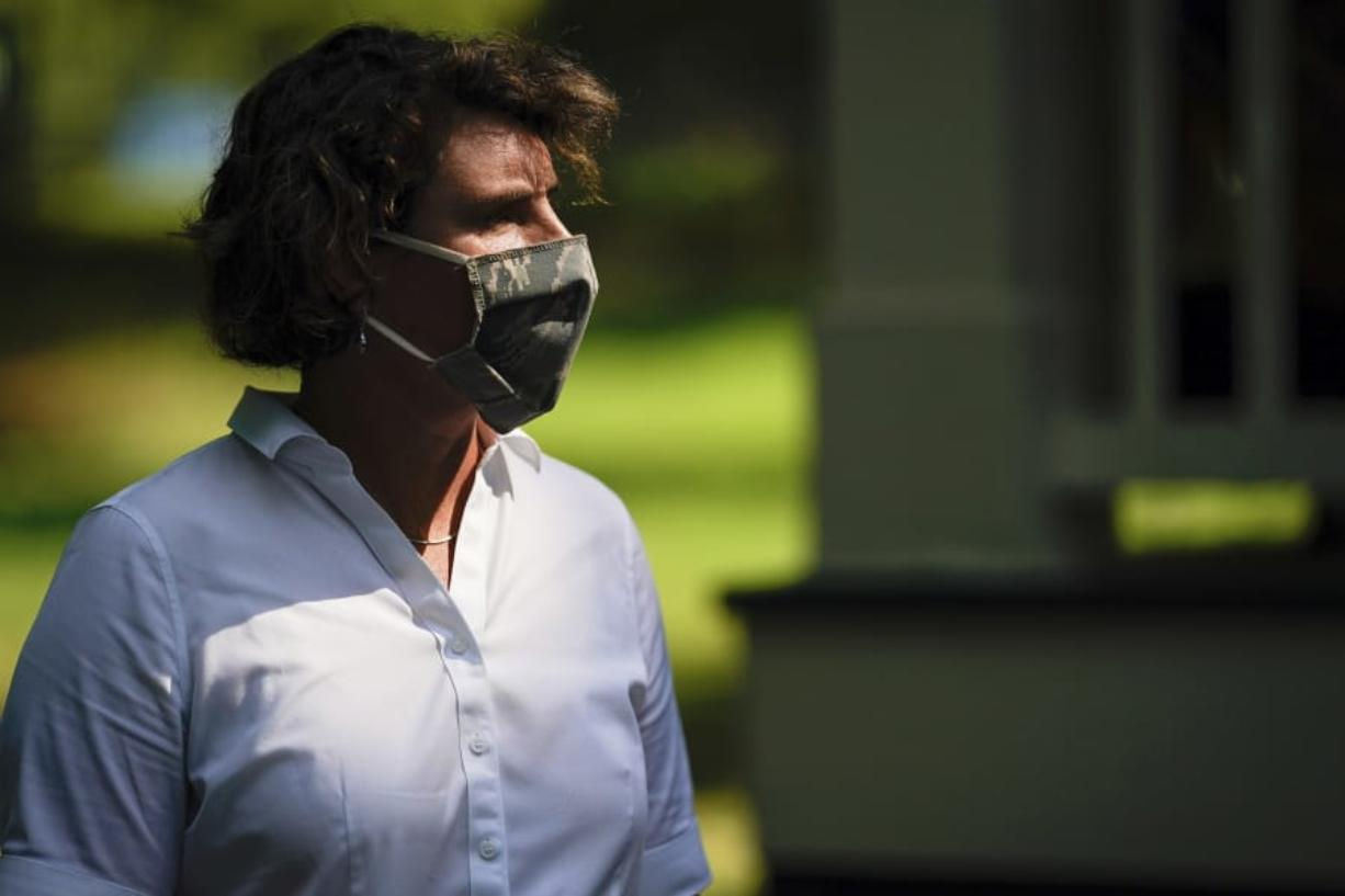 FILE - In this Aug. 25, 2020 file photo, U.S. Senate candidate Amy McGrath wears a face mask as she holds a rally with supporters during a campaign stop at Woodland Park in Lexington, Ky. Amy McGrath will face U.S. Senate Majority Leader Mitch McConnell on Election Day in November.