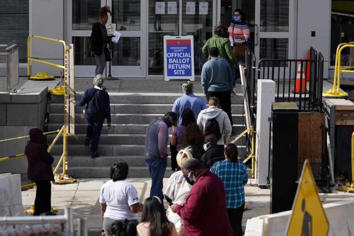 Residents line up outside the Montgomery County, Pa., Voter Services office, Monday, Oct. 19, 2020, in Norristown, Pa. Monday is the last day in Pennsylvania to register to vote in the Nov. 3 election in which the presidential battleground state is playing a central role in the contest between President Donald Trump and former Vice President Joe Biden.