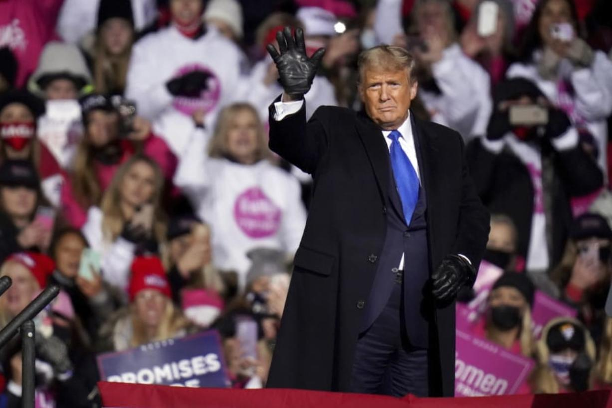 President Donald Trump waves after speaking at a campaign rally in Omaha, Neb., Tuesday, Oct. 27, 2020.