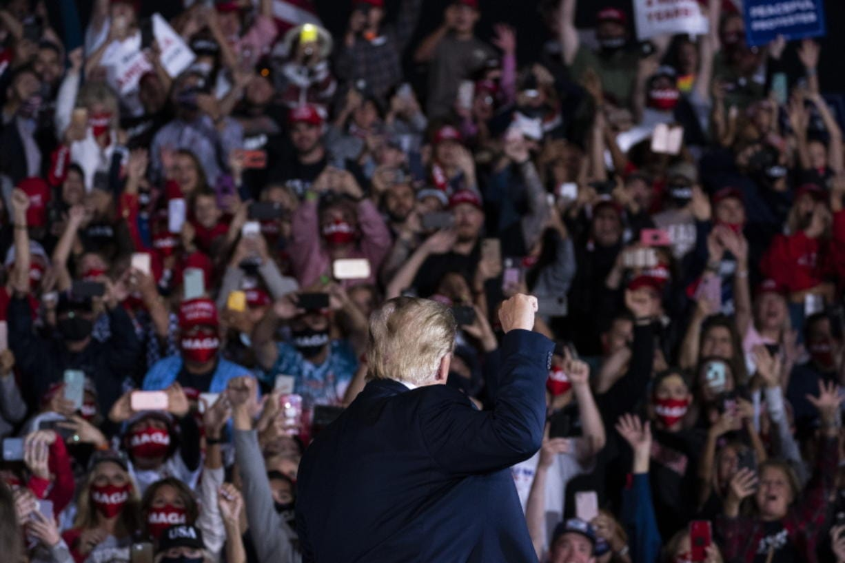 President Donald Trump arrives to speak to a campaign rally at Middle Georgia Regional Airport, Friday, Oct. 16, 2020, in Macon, Ga. (AP Photo/Evan Vucci) (scott p.